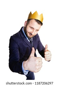 The concept of success. Portrait of a bearded man with a golden crown on his head on isolated white background.