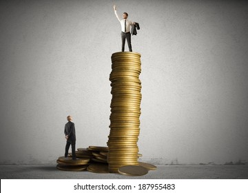 Concept of successful businessman on top of a stack of coins