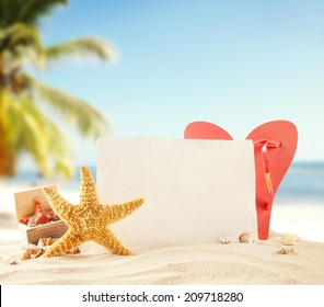 Concept of summer beach with starfish, shells and empty paper fr message.
