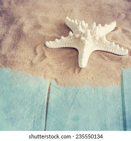 Concept of the summer time with fish star on the wooden blue background