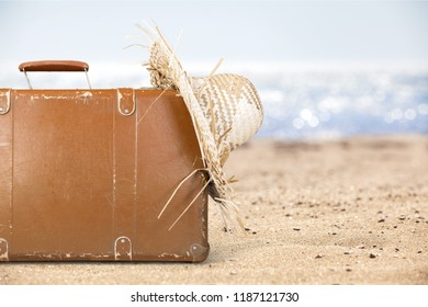Concept of summer travelling with old suitcase