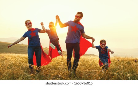 concept of super family, family of superheroes at sunset in nature