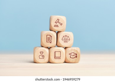 Concept of the system of work of court and justice on a pyramid of wooden blocks.