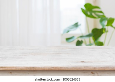 Concept of table for product display over defocused window background