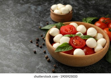 Concept of tasty eating with mozzarella cheese on black smokey background, space for text