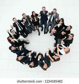 concept of team building.large business team sitting in a circle
