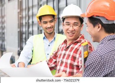 Concept Teamwork of building construction staff. Project engineer / contractor reviewing plan of work with foreman and worker at construction site.