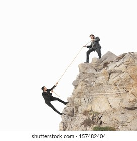 Concept of teamwork with climbing businessman