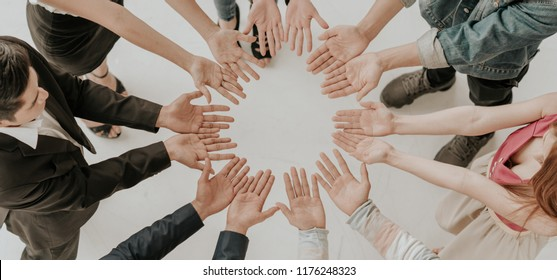 The concept of teamwork, cooperation, team building, corporate and community volunteers of different nationalities. The professional leadership initiatives. Share Society for charity.