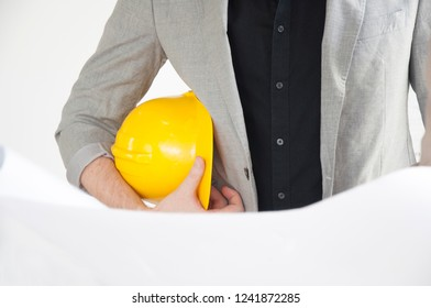 Concept : Technician and builders and engineers and mechanics and Construction Worker and Architecture  People - Architecture in gray suit and black shirt with helmet and blueprint on white background