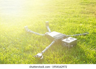 The concept of technology development in the form of artificial intelligence in a robot lives and experiences feelings lying on the grass.