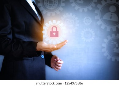The concept of technology icon business. Business woman working with virtual screen of internet data security and safety is lock computer construction in company.
