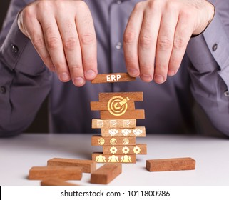 The concept of technology, the Internet and the network. Businessman shows a working model of business: ERP