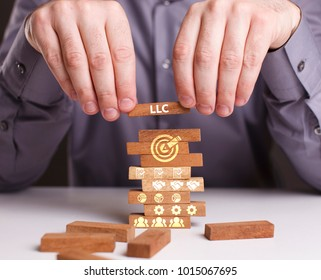 The concept of technology, the Internet and the network. Businessman shows a working model of business: LLC