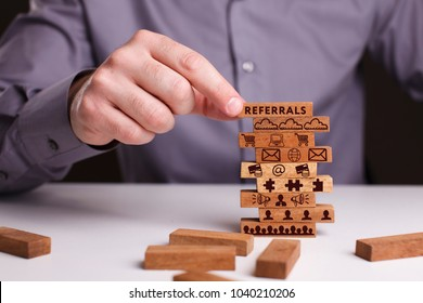 The concept of technology, the Internet and the network. Businessman shows a working model of business: Referrals