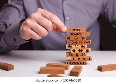 The concept of technology, the Internet and the network. Businessman shows a working model of business: Hotel search