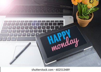 Concept technology tablet and laptop on office table decoration with word HAPPY MONDAY