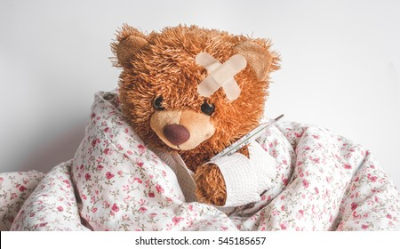 concept teddy bear childhood diseases at textile background