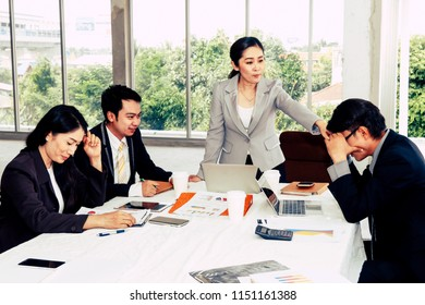 Concept Tense Business Meeting : Businessmen sit down because they are severely blamed for creating problems and making the organization sluggish : Selective Focus