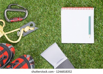 concept of things for extreme camping on green grass background