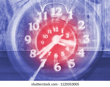 Concept of time passing on a analog clock with blurred zoom effect. Fast time passing, life time goes fast.