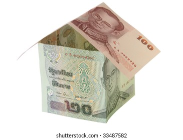 Concept towards real estate and house construction financing. A single house made of different Thai Baht banknotes on white background. Includes clipping path.