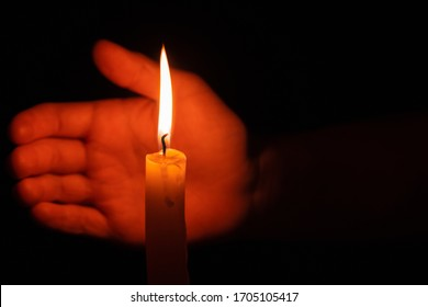 Concept of tragedy or requiem. Memorial service for dead and deceased. Rite in church, memorial service. Sorrow, loss. Ceremony with burning candle in hand in dark
