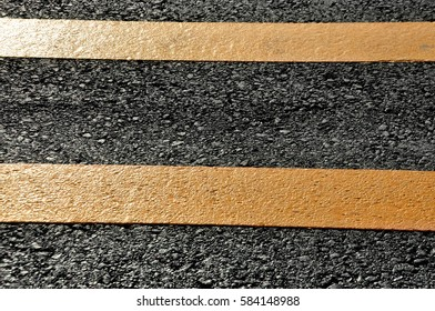 Concept of the transportation. Textural double solid lines on the asphalt road surface.
