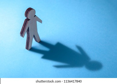 The concept of transvestite or bisexual. Tranender, man feels like woman. Shadow of man in the shape of woman