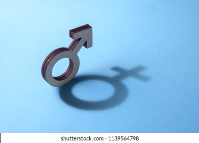 The concept of transvestite or bisexual. Tranender, man feels like woman. Shadow of gerner symbol of man in the form of symbol of woman