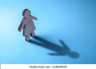 The concept of transvestite or bisexual. Tranender, woman feels like man. Shadow of woman in the form of man