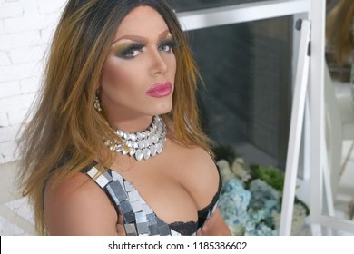The concept of a transvestite. Man-actor turns into a woman. he is posing for the camera