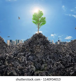 Concept of trash dump. Garbage dump in form of mountains with a growing tree on a city skyline background. Save the planet. Concept of recycle.