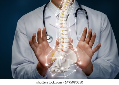The concept of the treatment of the spine. The doctor produces manipulation with the spine on a blue background.