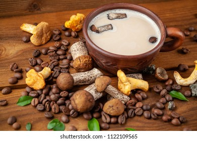 Concept of trend modern food industry. Mushroom coffee from mushrooms Chaga, a ceramic cup on a wooden background with coffee beans. Cappuccino, hipster, latte, instagram. Copy space, selective focus.
