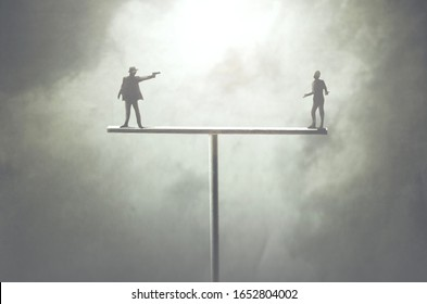 concept of two men fighting on unstable structure, karma concept