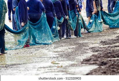 The concept of unity of fishermen, fishing, trawlers, nets, beach  ,  Fisherman At Work