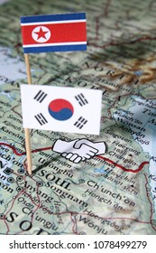 Concept of unity handshake at the Panmunjom border between North and South Korea
