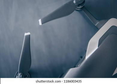 The concept of using drones in life and industry. Close up drone Engines and blades macro Details. Copy space. Innovation photography concept. Mate color. A new black drone on a black table.