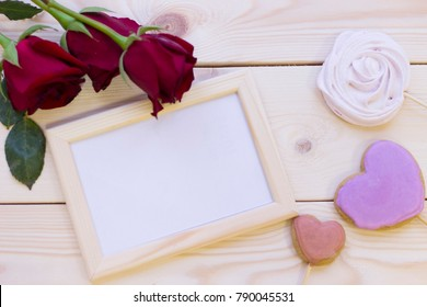 Concept of valentine's day with red roses and photo frame mock up on wooden background