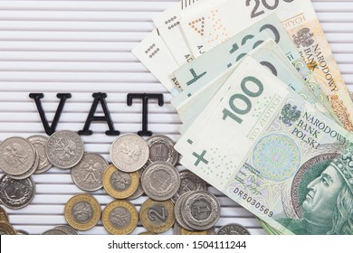 The concept of VAT and Polish banknotes and coins on a white board