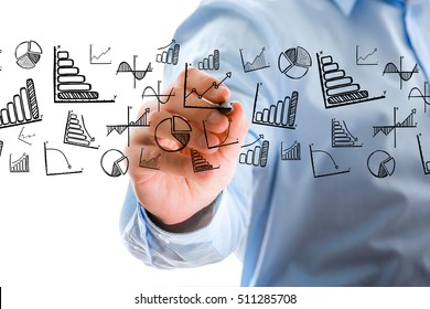 Concept view of businessman writing business icons all around