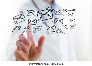 Concept view of Doctor touching email icon on technology interface