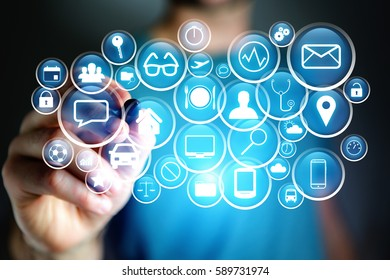 Concept view of multimedia icon flying over device on a technology interface - Internet concept