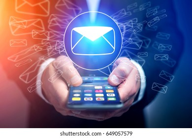 Concept view of sending email on smartphone interface with message icon around