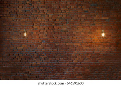 Concept vintage bulbs on brick wall background, copy space for text