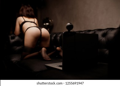 Concept virtual sex chat. Woman working as Internet webcam model.