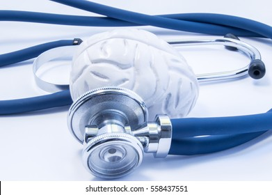 Concept of visualization or imaging diagnosis and treatment of diseases of brain using brain model and stethoscope, which like examine of brain, close up in fluorescent blue color on white background
