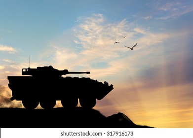 Concept of war. Silhouette military APCs at sunset
