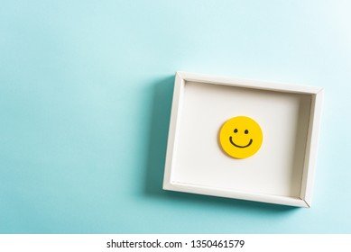 Concept of well done sign emoji, feedback, employee recognition award. happy yellow smiling cartoon face frame on blue background.